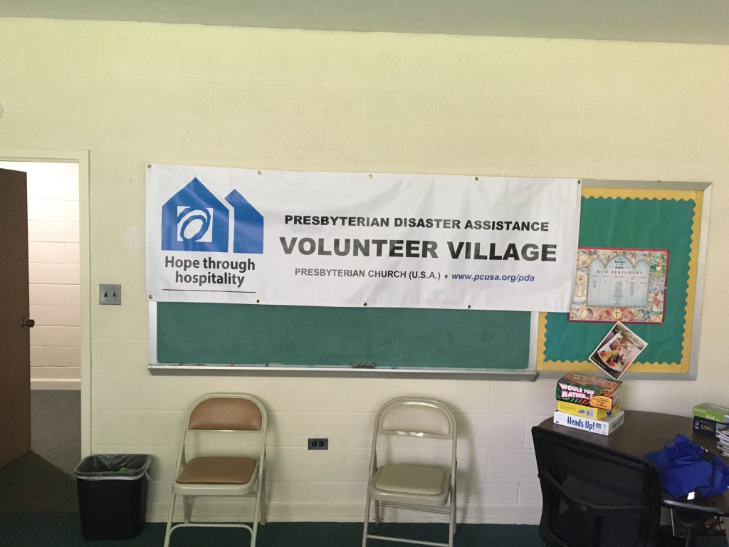 Lounge area and signage for the Volunteer Village at First Presbyterian Church of Kinston